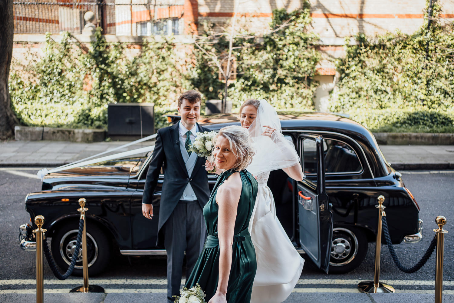 bride in traditional london taxi