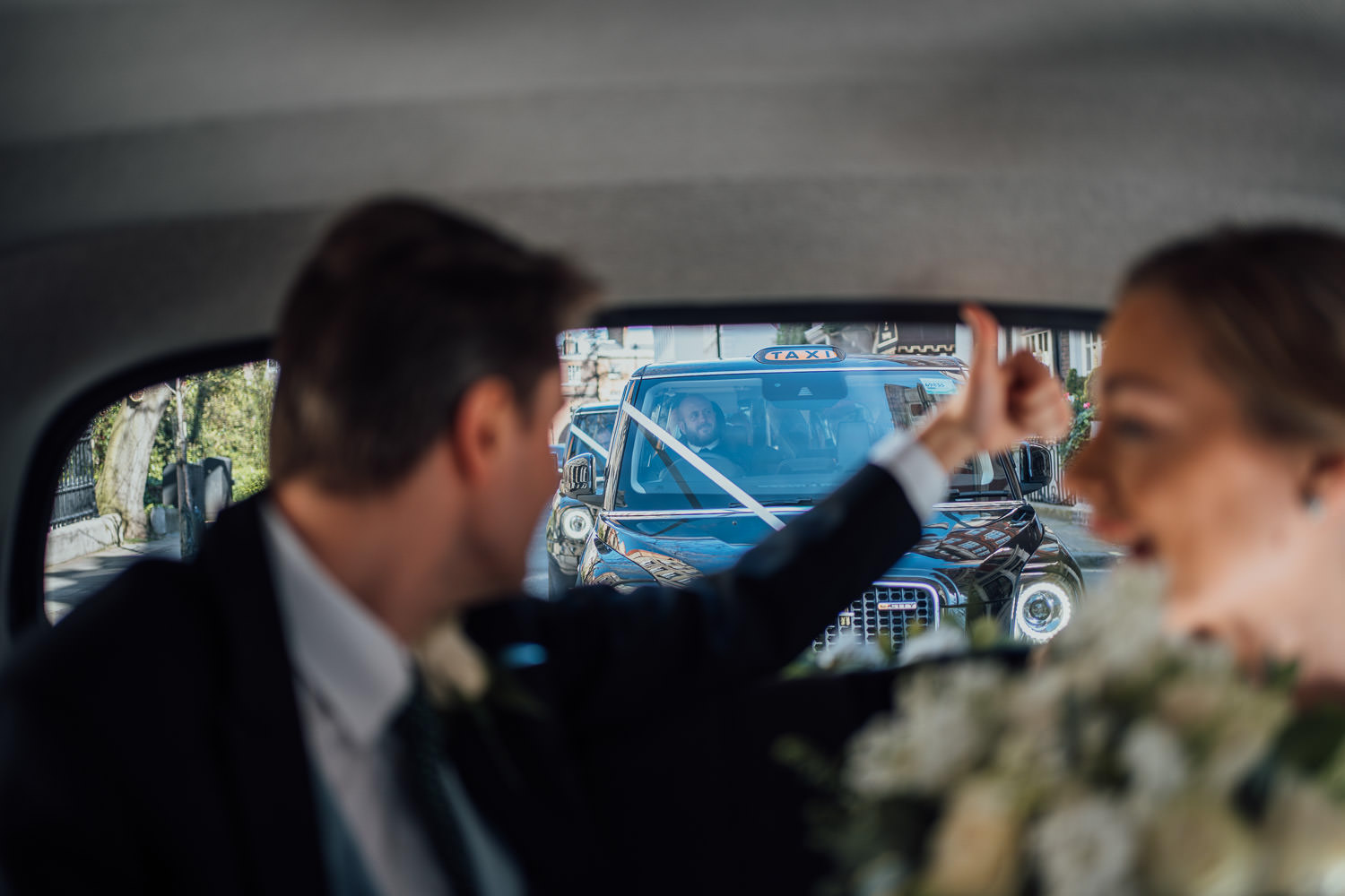 bride and groom in london taxi by creative and alternative london wedding photographer the shannons photography