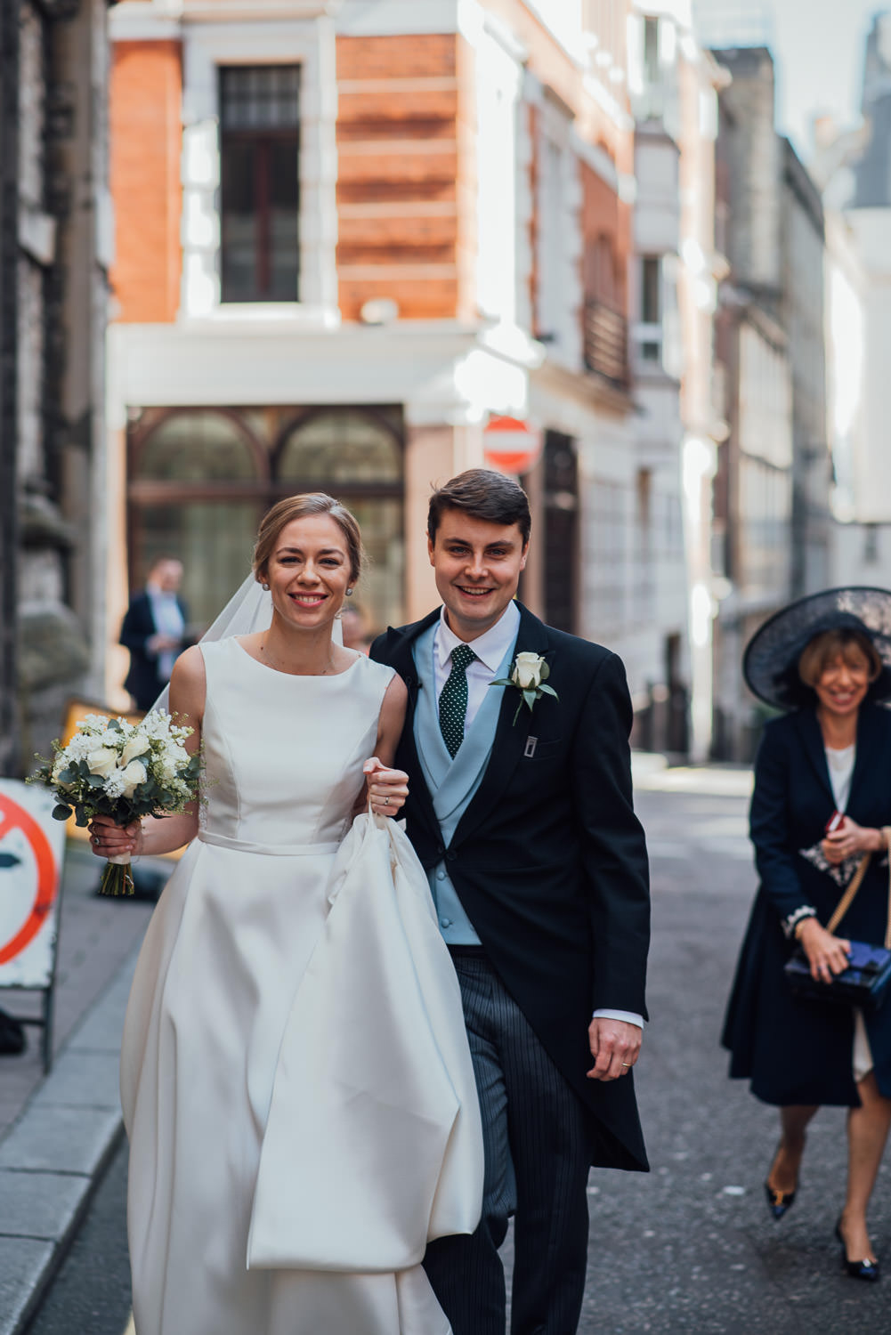 bride walking through empty london streets by alternative wedding photographer the shannons photography