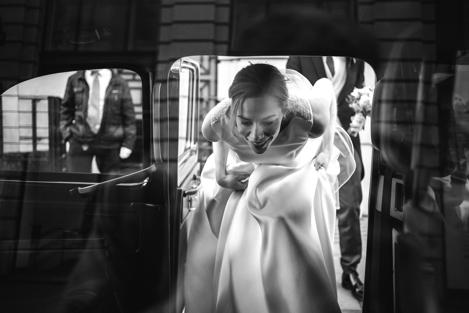 bride in london taxi by documentary london wedding photographer the shannons photography