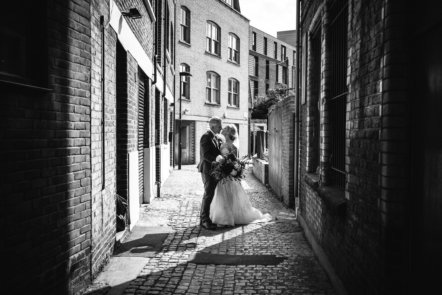 bride and groom in hackney town hall wedding by london wedding photographer the shannons photography