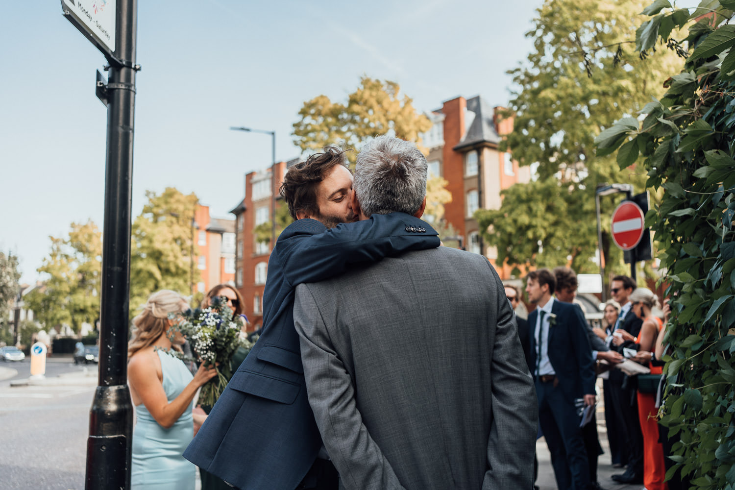 groom hugging in the roost dalston pub wedding