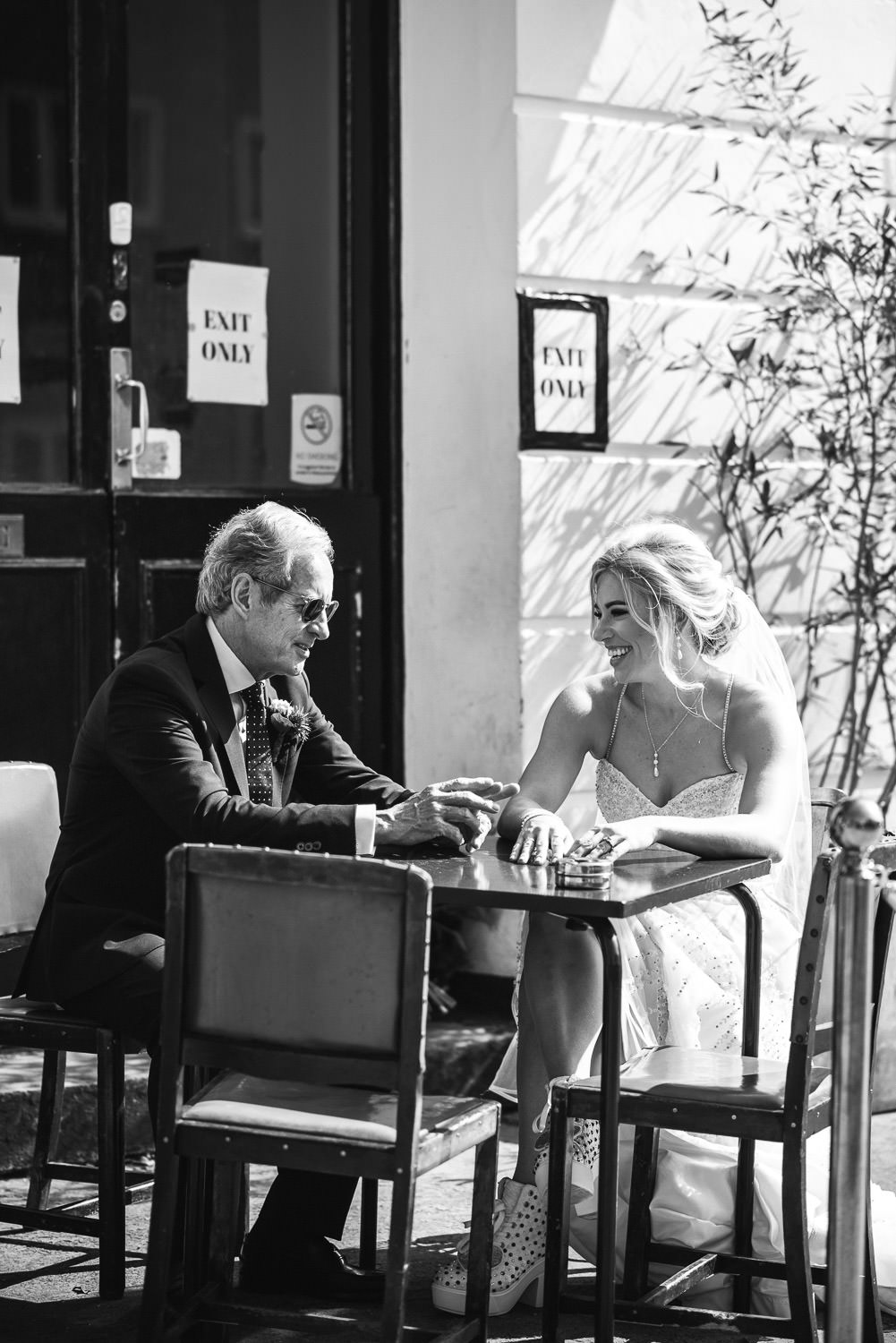 bride drinking with father in london lockdown wedding
