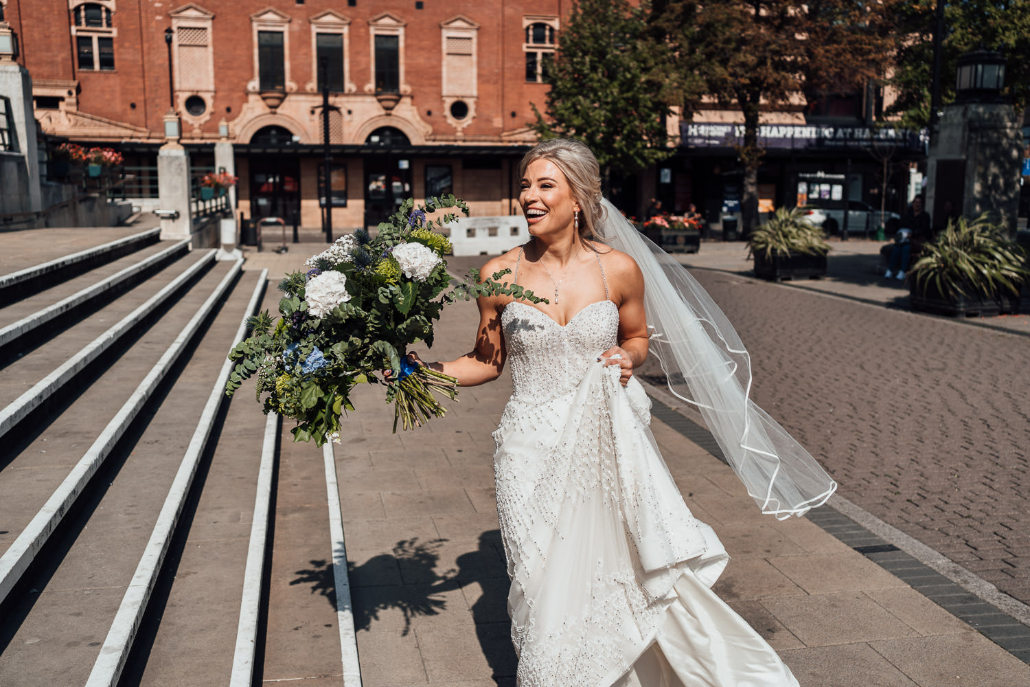 bride arriving at hackney town hall wedding by london wedding photographer the shannons photography