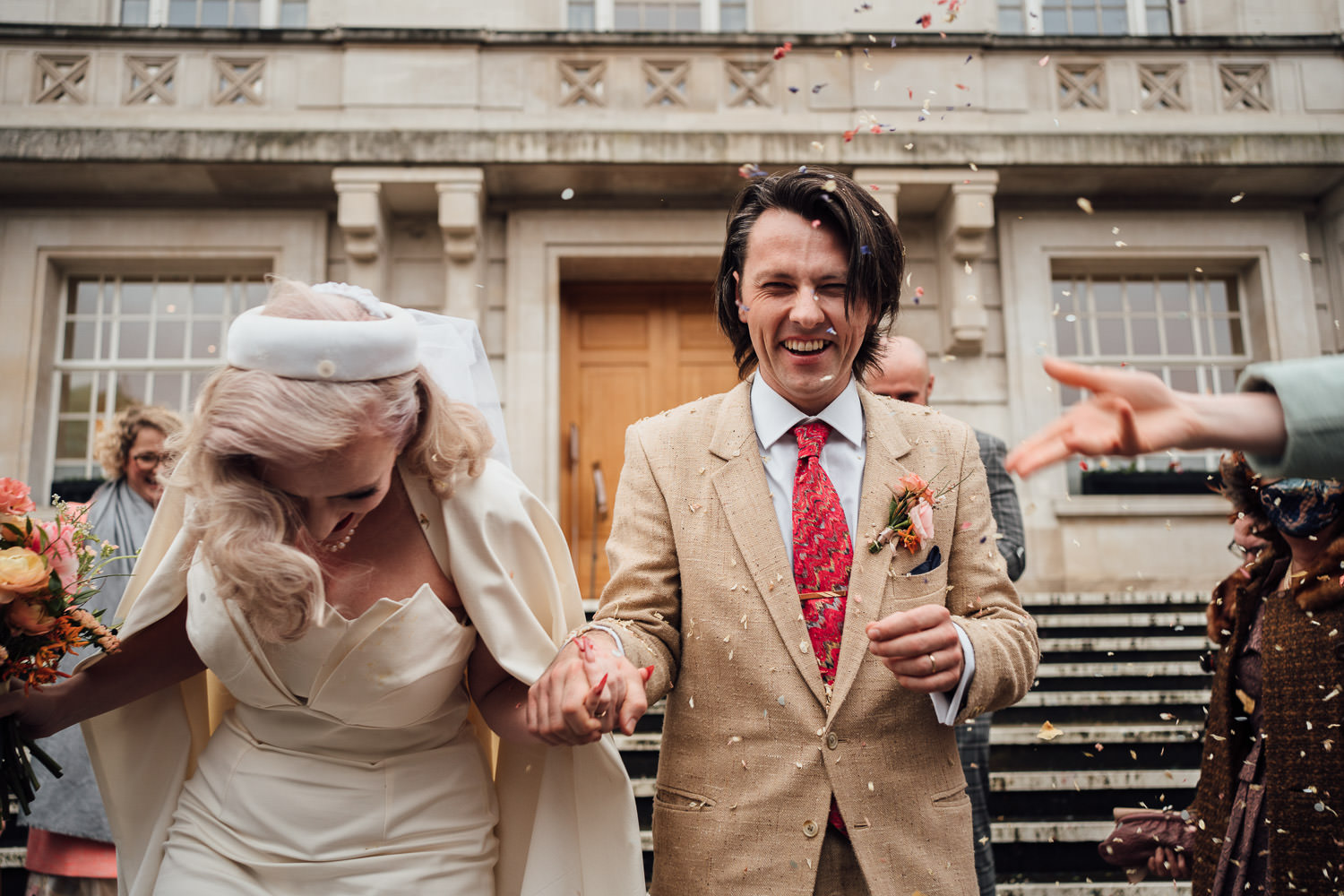 confetti throw in hackney town hall wedding by alternative wedding photographer the shannons photography