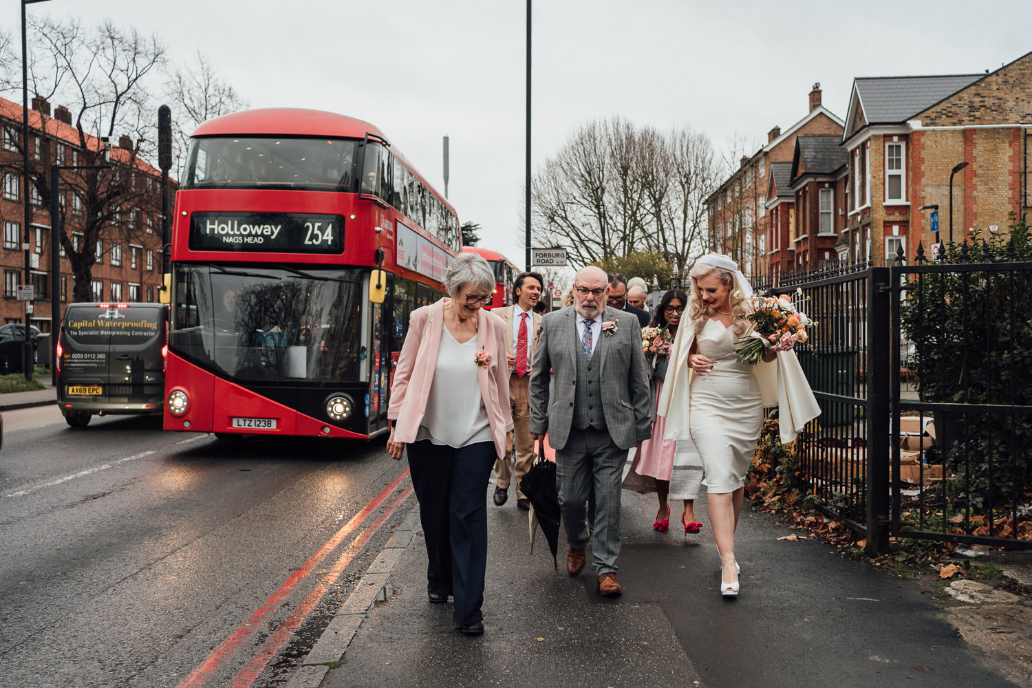 wedding party on london bus by documentary wedding photographer the shannons photographer
