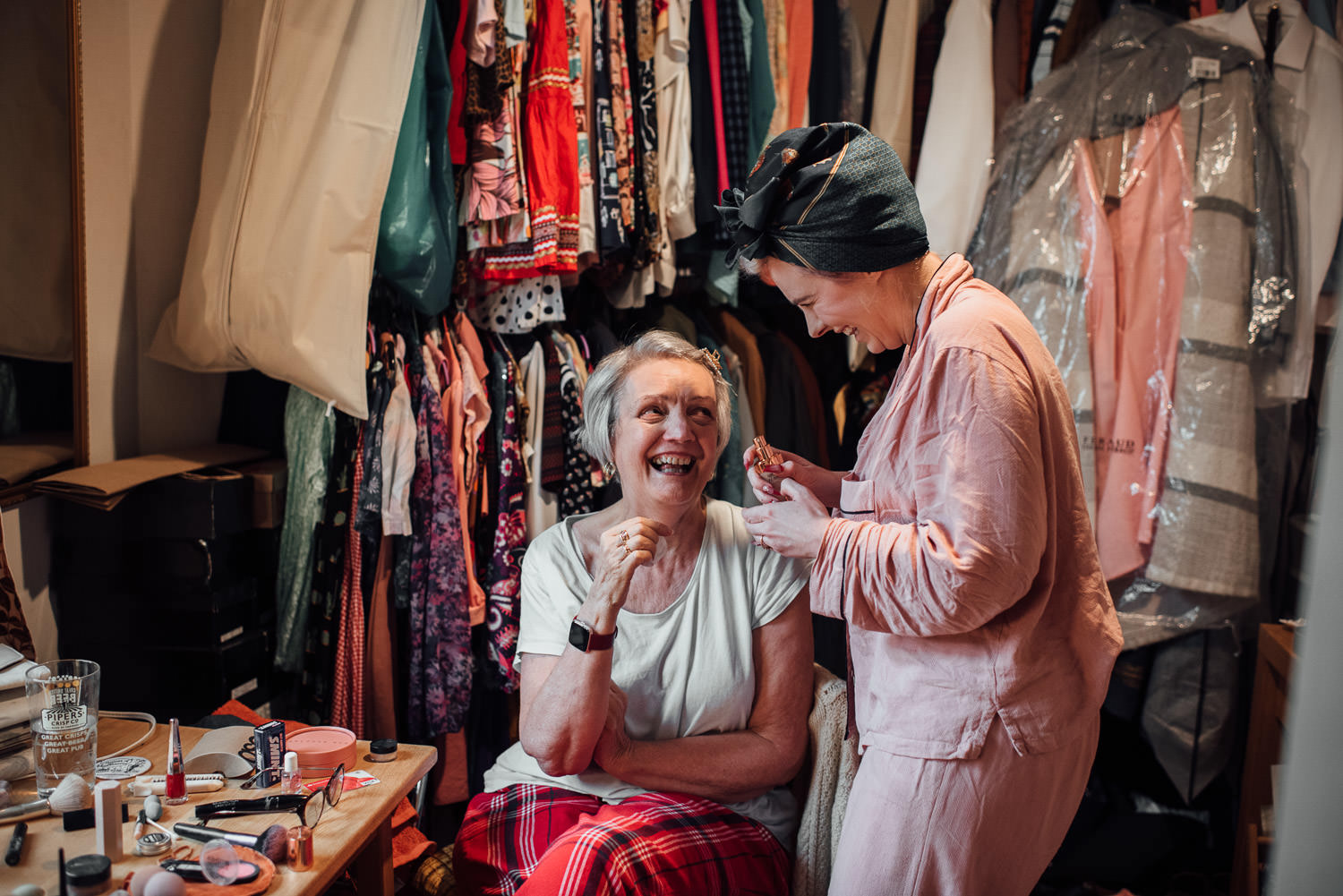 mother of the bride getting ready in retro styled wedding